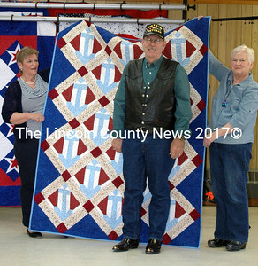 """Gerald Miller received the quilt """"Anchors Aweigh"""" at Sunday's presentation. Miller served as an EN-1 with the Navy in Saigon from 1972-1973. For his work as Navy Fleet Command Advisor to the Vietnamese Navy he received the Navy Commendation Medal, Armed Force MUC, and the Gallantry Cross. (Eleanor Cade Busby photo)"""