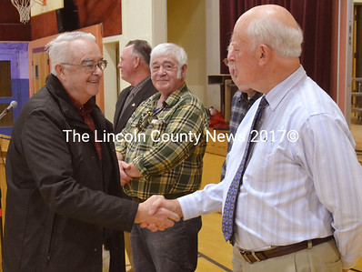 Selectman Ted Wooster (right) shakes the hand of Bill Blodgett, Waldoboro's county commissioner and a volunteer with the town's budget committee, the Waldoboro Food Pantry, the local Lion's Club, and the Waldoborough Historical Society. Blodgett was one of over 500 volunteers recognized. (D. Lobkowicz photo)