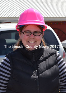 Nikki Ripley dons a pink hard hat Friday, April 17 to help her serve her new role as Whitefield's EMA director. (Abigail Adams photo)