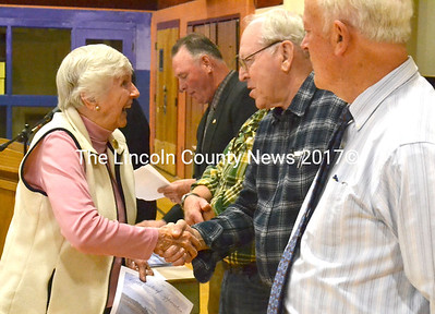 Former state representative Jeanne Begley, a volunteer with the United Methodist Church Women's Club, shakes the hand of Selectman Carl Cunningham at Waldoboro Volunteers Day. (D. Lobkowicz photo)