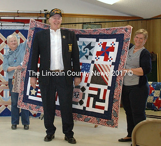 """Donald D. Hastings served in the Air Force as a Sergeant in Vietnam in 1964. He was given the quilt """"Gratitude,"""" made by Diane Hodgkins. (Eleanor Cade Busby photo)"""
