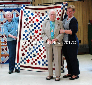 """Harriet Hibbard, of South Bristol, and Damariscotta was awarded the quilt """"Stair Steps to the Stars"""" for her service as a sergeant with the Army Air Corps during World War II. She is shown with quilters Betty Holzer, left, and  Sheila Hall, right. (Eleanor Cade Busby photo)"""