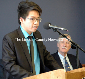 Lincoln Academy senior Thanh Tran talks about his experience as a boarding student at L.A. as Sen. Angus King looks on during the ribbon-cutting ceremony for the new residence hall and technology center at Lincoln Academy Friday, April 17. Tran is from Vietnam. He plans to attend Bowdoin College in the fall after two years at L.A. (J.W. Oliver photo)