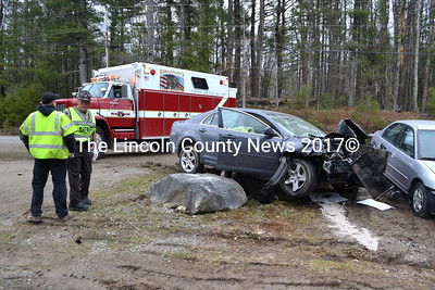 This Chevrolet Malibu struck two pickup trucks on Center Street in Nobleboro before coming to rest, according to Lincoln County Sheriff's Sgt. Alan Shea. The operator was taken to the hospital, he said. (D. Lobkowicz photo)