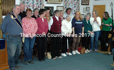 A large group of Waldoboro/Bremen Food Pantry volunteers was present at Meenahga Grange on April 27 when co-directors Ellie Simons and Lou Cook accepted the Spirit of America Award on behalf of the entire group. Also present were representatives from the Waldoboro Lions Club, which has sponsored the food pantry for many years, and from the United Methodist Church, which serves as home for the pantry. (Laurie McBurnie photo)