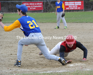 Daren Wood dives back to first safe, as Boothbay first baseman Grant Giles makes the catch. (Paula Roberts photo)