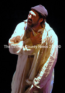 "Jean Valjean (Dennis St Pierre) asks himself what his new freedom means in ""Les Miserables."" (Eleanor Cade Busby photo)"