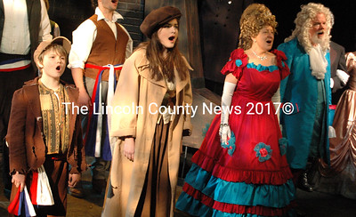 """The ensemble performs """"Do You Hear the People Sing?"""" part of the finale of """"Les Miserables."""" Shown left to right, Andrew Lyndaker, Noelle Timberlake, Dixie Weisman, and Joe McGrann. (Eleanor Cade Busby photo)"""