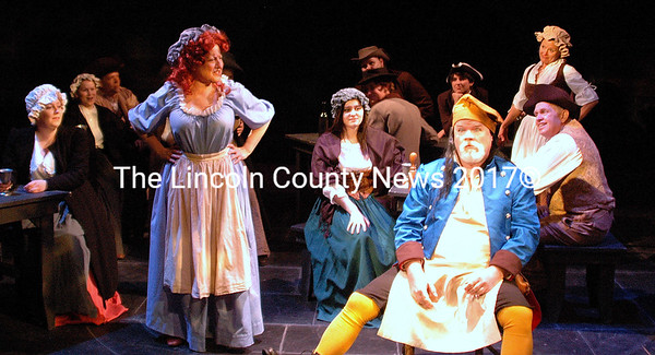 """The Thenardiers toast to the """"Master of the House"""" in their boarding house in Heartwood's production of  """"Les Miserables,"""" opening April 30. (Eleanor Cade Busby photo)"""