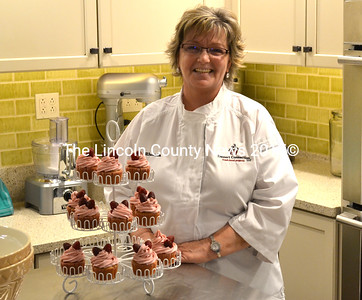 Rhonda Flagg, owner of Dessert Connection, stands with a dozen raspbery lemon cupcakes she made for teacher appreciation week at Jefferson Village School. (D. Lobkowicz photo)