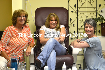 Hair Frolicks Salon & Spa owner Terry Chapman (left) and stylist Lynne Steele (right) pose with the salon's new stylist, Pat Ripley.