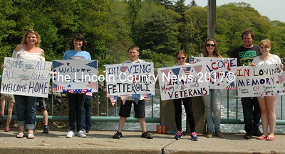 Welcome home signs lined the Damarsicotta Newcastle Bridge during the Twin Villages Memorial Day Parade. Many people along Main Street held sign of thanks and welcome home. Shown left to right, Dede Grant, Heather Hilton Hartford, Jacob Kurr, Alivia Kurr, Julia Kurr, Marcus Makinen and Alexis Fetterroli. (Eleanor Cade Busby Photo)