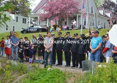 Members of the Waldoboro Fire Department salute as Taps is played during Memorial Day ceremonies. (D. Lobkowicz photo)