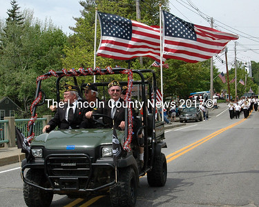 Wells-Hussey American Legion Post Commander Roy Benner chauffers veterans in the Twin Villages Memorial Day Parade Monday. The wind was high on the Damariscotta-Newcastle Bridge and the flags flew high. (Eleanor Cade Busby photo)