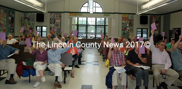 Damariscotta voters approve the special education category of the 2015-2016 secondary education budget during a special town meeting in the Great Salt Bay Community School cafeteria Thursday, May 28. (J.W. Oliver photo)