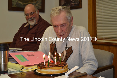 Westport Island First Selectman George Richardson prepares to blow out the candles on his birthday cake during a surprise birthday party at the town office Monday, June 1. (Charlotte Boynton photo)