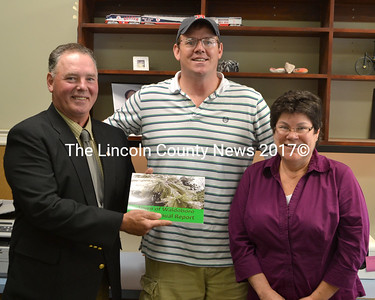 Waldoboro Selectman Chair Clint Collamore (left) and Town Manager Linda-Jean Briggs present a copy of the town's 2014 annual report to Scott Murray. Along with the late Randy Raymond, the town report is dedicated to John Murray, Scott's father, who passed away last December. (D. Lobkowicz photo)