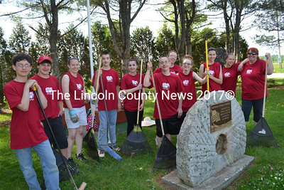 Whitefield Elementary School seventh-graders take a break from sweeping and raking at the Whitefield town office during their Day of Caring Thursday, May 28. (Charlotte Boynton photo)