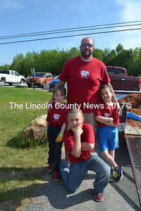 Whitefield Elementary School Principal Josh McNaughton takes a break with three of his helpers during the school's Day of Caring. (Charlotte Boynton photo)