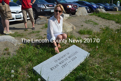 The mother of Ryan Wayne Mullens, Stacy Savage, reviews a stone for a memorial bench in memory of her son Thursday, May 28. The Whitefield Elementary graduate died in an ATV accident last year, shortly after completing his sophomore year at Wiscasset  High School. (Charlotte Boynton photo)