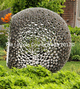 """""""Memory of Water,"""" made of stainless steel and mirrors, shimmers near the turn to the Children's Garden. (Eleanor Cade Busby photo)"""