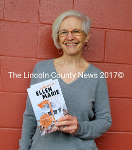 """Rachel Spaulding holds a copy of her debut book, """"The Search for Ellen Marie."""" The book documents her search for a fishing vessel built at Gamage Shipyard in South Bristol. (Eleanor Cade Busby photo)"""