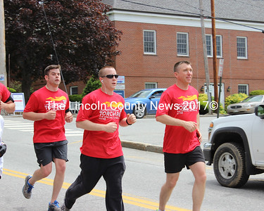 Participants in the 2015 Special Olympics Torch Run jog down Main Street in Damariscotta on June 3. From left: LCSO Detective Jard Mitkus, LCSO Deputy Sherriff Ryan Chubbuck, and Damariscotta Officer Erick Halpin. (Olivia Canny photo)