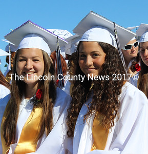 Leslie Sandefur and Tess Fields await the conferring of diplomas at Lincoln Academy's graduation ceremony June 4. (Olivia Canny photo)