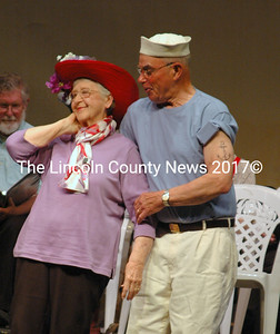 """Hearts Ever Young cast members Carolyn Gray and John Harris ham it up in the """"Love Song Medley"""" during the troupe's performance of """"We're on Our Way: On the Road with HEY."""" (Eleanor Cade Busby photo)"""