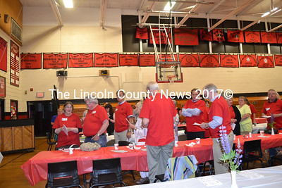 """The class of 1965 made a strong showing for its 50th reunion at the Wiscasset alumni banquet Saturday, June 6. Members of the class distinguished themselves by wearing T-shirts with their school colors and black lettering reading """"WHS Class of 1965."""" (Charlotte Boynton photo)"""