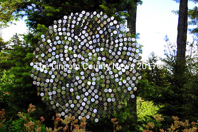 """""""Memory of Fibonacci"""" is a kinetic sculpture that reacts to the sun and wind and reflects the colors of the surrounding forest. (Eleanor Cade Busby photo)"""
