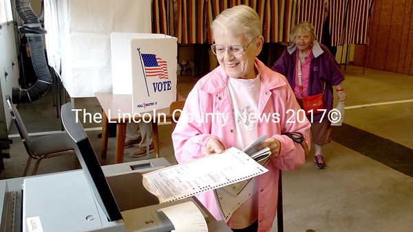 Marie Delia Gervais casts her ballot at Waldoboro's annual referendum town meeting June 9. (D. Lobkowicz photo)