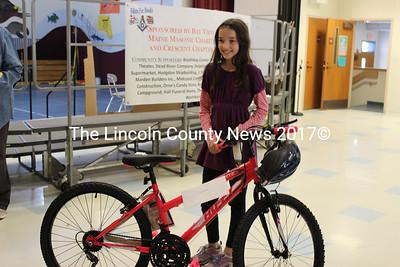 Edgecomb Eddy School student Madison Phelps won the last bike at the ceremony. (Olivia Canny photo)