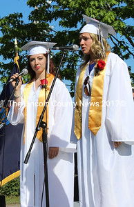 """Accomanied by pianist Than Tran (not shown), Rowan Carroll-Christopher and Danielle Pinkham sing """"The Call"""" at Lincoln Academy's graduation ceremony. (Olivia Canny photo)"""
