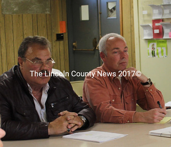 Tony Casella (left) and land surveyor Karl Olson discuss the final application for a three-cottage development on Davis Island with the Edgecomb Planning Board June 4. (Olivia Canny photo)