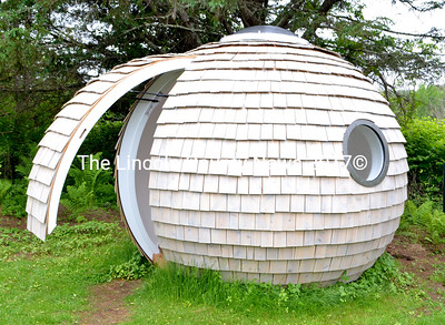 Judy Bernier, of Waldoboro, and Chris Sneesby, of Yorkshire, England, the original designer of the Archipod, built this pod in Bernier's backyard in Waldoboro. Bernier's company, Podzook, is now the licensed manufacturer of Archipods in the United States. (D. Lobkowicz photo)