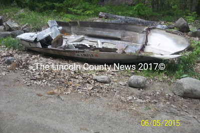 An old boat infringes on the town right-of-way on Baker Road in Westport Island, according to selectmen. The selectmen have instructed resident Albert Greenleaf to remove the boat and other debris by June 19 or face a lawsuit. (Photo courtesy Westport Island selectmen)