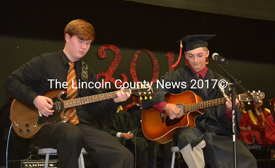 "Graduating senior Tyler Flavin (right) performs his original composition ""Dreams Can Inspire,"" at Wiscasset's Class of 2015 graduation ceremony June 11. Flavin was accompanied by guest musician, junior Sam Smith. (Abigail Adams photo)"