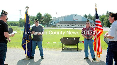 Wells-Hussey Legionnaires serve as the color guard and honor guard for the retirement of 2,500 flags on Flag Day. (Eleanor Cade Busby photo)
