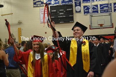Class marshals Erika Auger (left) and Paul J. Hodgdon lead the 42 seniors of Wiscasset's Class of 2015 in their commencement ceremony June 11. (Abigail Adams photo)