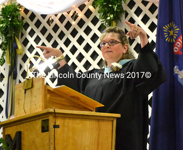 In the evening address, Medomak Valley High School English teacher Linda Pease encouraged graduates to take on three qualities of bamboo: patience, flexibility, and rootedness. (D. Lobkowicz photo)
