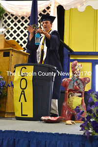 "Salutatorian Gavin Felch pulls ""success"" (represented by a bottle of Gatorade) out of a mix of ""guts,"" ""grit,"" and ""humanity"" during his address. (D. Lobkowicz photo)"