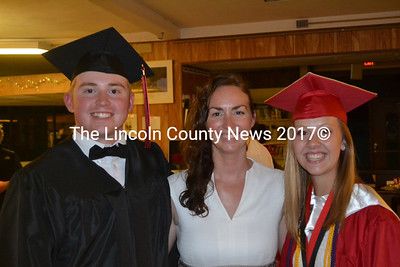 "Suprise guest speaker at Wiscasset High School's graduation Eva Castor (center) stands with graduating senior Matthew Craig and Salutarian Hannah Welborn June 11. Castor has worked with the Class of 2015 since she began teaching in Wiscasset. ""You are my family,"" Castor said to them in her speech.(Abigail Adams photo)"