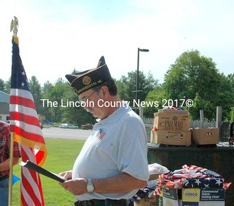 The American Legion Wells-Hussey Post No. 42 Chaplain Vaughn Fish leads a prayer during the flag retirement ceremony at the post in Damariscotta Sunday, June 14. (Eleanor Cade Busby photo)