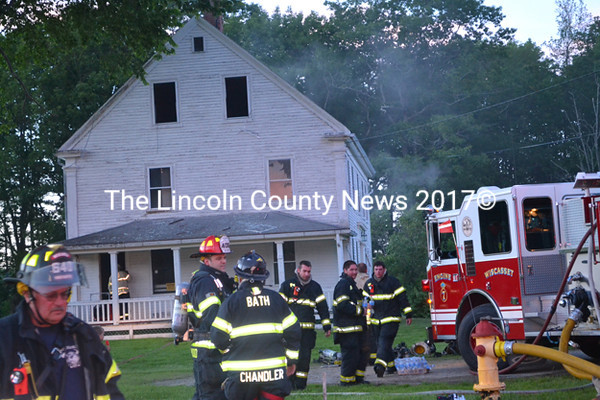 Approximately 25 volunteer firefighters from six departments quickly extinguished a fire in the basement of a vacant house on Old County Road in Wiscasset Thursday, June 25. (Abigail Adams photo)
