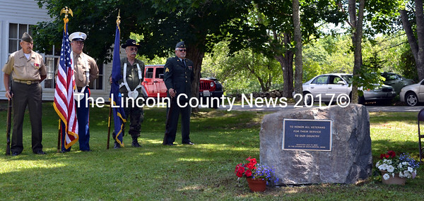 A color guard stands by at the dedication of the South Bristol veterans memorial Friday, July 17. From left: Gary Pitcher, Ralph Eugley III, Mike Zuchowski, and Bruce Poland. (J.W. Oliver photo)