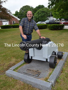 """Wiscasset author Phil DiVece stands next to a Civil War cannon that he writes about in his new book, """"More Wiscasset and Its Times: Other Stories of Maine's Prettiest Village. (Charlotte Boynton photo)"""