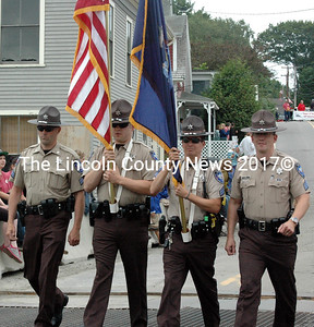 The Lincoln County Sheriff's Office color guard leads the South Bristol centennial parade Saturday, July 18. From left: Detedtive Sgt. Ronald Rollins, Detective Jared Mitkus, Sgt. Matt Day, and Sgt. Jason Nein. (Aidan Collins photo)