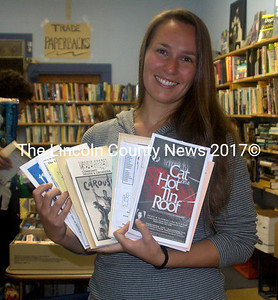 """Laura Whitney, a music teacher from Wiscasset,  discovered playbills from the  early days of the Lincoln County Community Theater at the rummage sale Saturday."""" I was  in this production of 'Our Town' ,"""" she said, """"What fun to find all these memories here."""" (Eleanor Cade Busby photo)"""