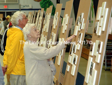 """The """"Down on the Island, Up on the Main"""" exhibit was a major attraction in the South Bristol School gym Saturday, July 18. The exhibit by the late author and historian Ellen Vincent was on display as part of the South Bristol centennial celebration. (J.W. Oliver photo)"""